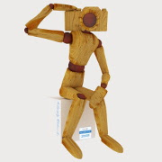 Anitography log - wooden man with camera head